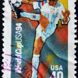 Royalty-Free Stock Photo: USA - CIRCA 1994:A post stamp printed in USA shows football player, devoted football world championship,USA, circa 1994.