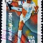 USA - CIRCA 1994:A post stamp printed in USA shows football player, devoted football world championship,USA, circa 1994. — Stock Photo #9445263