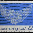 USA - CIRCA 1980: A stamp printed in USA shows image of the dedicated to the Lace is an openwork fabric, patterned with open holes in the work, made by machine or by hand, circa 1980. - Stock Photo