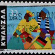 UNITED STATES OF AMERICA - CIRCA 1997: A stamp printed in USA dedicated to kwanzaa, circa 1997 - Stock Photo