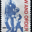Stock Photo: UNITED STATES - CIRC1968: stamp printed in USshows police as protector and friend and respect for law and order, circ1968