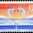 UNITED STATES OF AMERICA - CIRCA 1997: Love Swans stamp printed in the USA, circa 1997 — Stock Photo #9445595