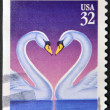 UNITED STATES OF AMERICA - CIRCA 1997: Love Swans stamp printed in the USA, circa 1997 — Stock Photo #9445618