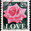 Stock Photo: UNITED STATES OF AMERICA - CIRCA 1982: A stamp printed in USA shows roses and love, circa 1982.