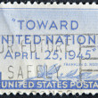 Stock Photo: UNITED STATES OF AMERICA - CIRCA 1945: a stamp printed in the USA shows olive branch and inscription Toward United Nations April 25,1945, United Nations Conference San Francisco, circa 1945