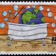 Stock Photo: UNITED STATES OF AMERIC- CIRC1995: stamp printed in USdedicated to 25th anniversary of Earth day, shows child's drawing of Christy Millard, age 12, circ1995