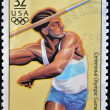 USA - CIRCA 1996: A stamp dedicated to centennial olympic games, shows man throwing the javelin, circa 1996. — Stock Photo #9446006