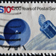 UNITED STATES OF AMERICA - CIRCA 1970: A stamp printed in USA dedicated to 200 years of postal service, shows Communications Satellite, circa 1970 — Stock Photo
