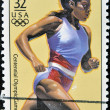 USA - CIRCA 1996: A stamp dedicated to centennial olympic games, shows woman running, circa 1996. — Stock Photo