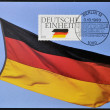 GERMANY - CIRCA 1990: A stamp printed in Germany dedicated to German Reunification, shows flag, circa 1990 - Stock Photo