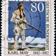 Stock Photo: GERMANY - CIRC1990: stamp printed in Germany, dedicated to 75th anniversary of death of Karl May, shows Apache Chief Winnetou, circ1990