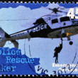 Stock Photo: AUSTRALI- CIRC1997: stamp printed in Australidedicated to emergency services, shows police rescue hiker, circ1997