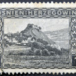 BOSNIA AND HERCEGOVINA - CIRCA 1906: A stamp printed in Bosnia and Hercegovina shows Doboj, a village in mountains, circa 1906 — Stock Photo