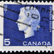 CANADA - CIRCA 1962: A stamp printed in Canada showing a portrait of Queen Elizabeth II and Agriculture symbol, circa 1962. - Stock Photo