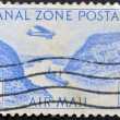 PANAMA CANAL ZONE - CIRCA 1983: A stamp printed in Panama Canal Zone shows floating on the canal boat and airplane, circa 1983 — Stock Photo