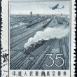 Stock Photo: CHIN- CIRC1957: stamp printed in Chinshows Steam locomotive on track, circ1957