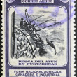 Stock Photo: COSTA RICA - CIRCA 1950: A stamp printed in Costa Rica dedicated to agricultural fair, livestock and industrial Carthage, shows fishing for tuna in Puntarenas, circa 1950