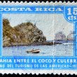 COSTA RICA - CIRCA 1972: A stamp printed in Costa Rica dedicated to the year of tourism in the Americas, shows the Bay between the coconut and snake, circa 1972 — Stock Photo