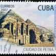 Stock Photo: CUBA - CIRCA 2007: A stamp printed in cuba dedicated to new wonders, shows the city of Petra, circa 2007