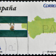 SPAIN - CIRCA 2009: A stamp printed in spain shows flag and map of the autonomous community of Andalucia, circa 2009 — Stock Photo