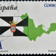 Stock Photo: SPAIN - CIRC2011: stamp printed in spain shows flag and map of autonomous city of Ceuta, circ2011
