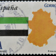 SPAIN - CIRCA 2011: A stamp printed in spain shows flag and map of the autonomous community of Extremadura, circa 2011 - Stock Photo
