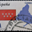 Stock Photo: SPAIN - CIRC2011: stamp printed in spain shows flag and map of autonomous community of Madrid, circ2011