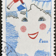 Royalty-Free Stock Photo: FRANCE - CIRCA 1981: A stamp printed in France dedicated to water,  shows children\'s drawing the map of France as one side being irrigated, circa 1981