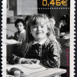 FRANCE - CIRCA 2002: A stamp printed in France shows a smiling girl in school, circa 2002 — Stock Photo #9449908