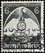 GERMAN REICH - CIRCA 1935: A stamp printed in Germany shows nazi eagle badge, circa 1935 — Stock Photo