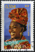 FRANCE - CIRCA 2004: A stamp printed in France shows madras headdress, circa 2004 — Stock Photo