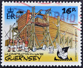 GUERNSEY - CIRCA 1992 : stamp printed in Guernsey shows bullet in the construction of an Egyptian ship, belonging to the comic Asterix and Obelix, circa 1992 — Stock Photo