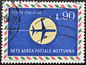 ITALY - CIRCA 1965: A stamp printed in Italy shows the drawing of the silhouette of an airplane on the moon, circa 1965 — Stock Photo