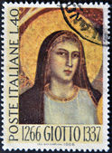 ITALY - CIRCA 1966: A stamp printed in Italy show picture of the Virgin Mary by Giotto, circa 1966 — Stock Photo