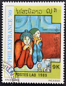 "LAOS-CIRCA 1989: A stamp printed in the Laos shows painting ""arlequins"" by Pablo Picasso, circa 1989 — Stock Photo"