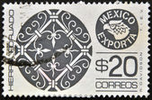 MEXICO - CIRCA 1975: A stamp printed in Mexico shows filigree ironwork with the words Hierro Forjado Mexico Exporta, circa 1975. — Stock Photo
