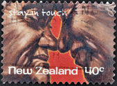 NEW ZEALAND- CIRCA 1998: A stamp printed in New Zealand shows elderly couple kissing, stay in touch, circa 1998 — Stock Photo