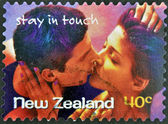 NEW ZEALAND- CIRCA 1998: A stamp printed in New Zealand shows couple kissing, stay in touch, circa 1998 — Stock Photo