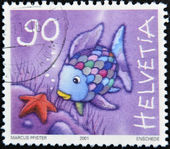 SWITZERLAND - CIRCA 2001: A stamp printed in Switzerland shows fish with colored scales, circa 2001 — Stock Photo