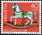 SWITZERLAND - CIRCA 1983: A stamp printed in Switzerland shows a wooden horse, circa 1983 — Stock Photo
