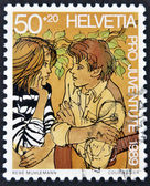 SWITZERLAND - CIRCA 1989: A stamp printed in Switzerland shows a young couple in love, circa 1989 — ストック写真