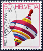 SWITZERLAND - CIRCA 1986: A stamp printed in Switzerland shows a peg-top, circa 1986 — 图库照片