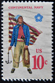 UNITED STATES - CIRCA 1970: A stamp printed in USA shows Military uniform of the American Continental Navy. Sailor with grappling hook, First Navy Jack, circa 1970 — Stock Photo
