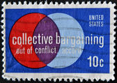 USA - CIRCA 1975 : A stamp printed in the USA shows Collective Bargaining: Out of Conflict … Accord, circa 1975 — Stok fotoğraf