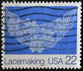 USA - CIRCA 1980: A stamp printed in USA shows image of the dedicated to the Lace is an openwork fabric, patterned with open holes in the work, made by machine or by hand, circa 1980. — Foto Stock