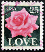 UNITED STATES OF AMERICA - CIRCA 1982: A stamp printed in USA shows roses and love, circa 1982. — Stock Photo