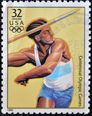USA - CIRCA 1996: A stamp dedicated to centennial olympic games, shows man throwing the javelin, circa 1996. — Stock Photo
