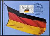 GERMANY - CIRCA 1990: A stamp printed in Germany dedicated to German Reunification, shows flag, circa 1990 — Stock Photo