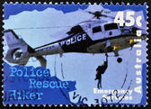 AUSTRALIA - CIRCA 1997: A stamp printed in Australia dedicated to emergency services, shows police rescue hiker, circa 1997 — Stock Photo