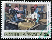 BOTSWANA - CIRCA 1985: A stamp printed in Botswana show woman sewing clothes, sewing machine, circa 1985 — Stock Photo